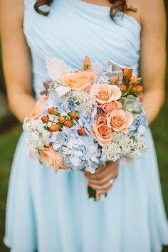 Baby Blue Bridesmaids with Peach Flowers in Bouquet. | http://prestonrichardson.com?utm_content=buffera7824&utm_medium=social&utm_source=pinterest.com&utm_campaign=buffer http://arcreactions.com/services/graphic-design/?utm_content=buffer19cdb&utm_medium=social&utm_source=pinterest.com&utm_campaign=buffer
