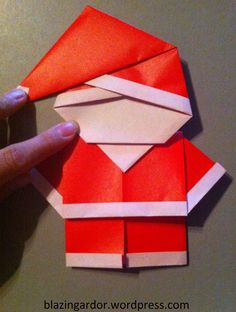 Origami Santa – How to guide as requested by Meredith :) Santa's Head 1. Get a standard size origami paper, red on one side, plain on the other. 2. Fold one edge in 1/2cm 3. Fold joinin…
