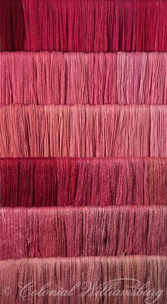Studio photography of various colors of yarn dyed at the Weaver's shop in Colonial Williamsburg. Shot for book by Max Hamerick on dyeing textiles; Red dyed with Cochineal ONLY Photo by Barbara Temple Lombardi - The cochineal lends a very crimson tone to the yarn, such that I'm reminded of the British Army officer's sash with the deeper samples.