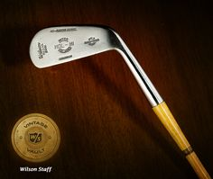 """For those of you who appreciate the beauty of golf clubs in their original design stages, may we introduce you to our first release from the Vintage Vault – the HOL-HI Matched Iron Model. Featuring the hammer forged, Chromium plated mild steel heads, hickory shafts and red and black Wilson bell top tapered grips, this 2 """"Midiron"""" from the early 1930s cost 7.50 in its day. The catalog guaranteed the steel heads """"will not rust or dull"""". LIKE if you believe that to be the truth."""