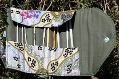 Would add a back zipper pouch to hold small notions like row counter, stitch marker, small scissors, yarn needle, etc