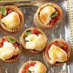 Tiny Tomato Tarts: With all the flavor of a traditional tomato pie, these Tiny Tomato Tarts will be a hit at your party!
