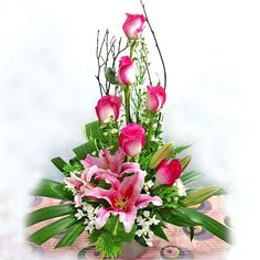 Price:  US$79.99    Pink Lilies And Roses Table arrangement
