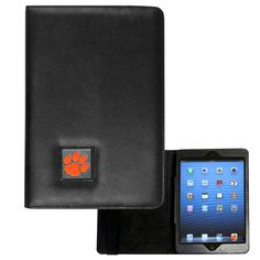 """Checkout our #LicensedGear products FREE SHIPPING + 10% OFF Coupon Code """"Official"""" Clemson Tigers iPad Mini Folio Case - Officially licensed College product Fits the iPad Mini tablet Complete access to the tablet while in the case  Stretch strap secures the case while closed Metal Clemson Tigers emblem with enameled team colors - Price: $22.00. Buy now at https://officiallylicensedgear.com/clemson-tigers-ipad-mini-folio-case-cmip69"""
