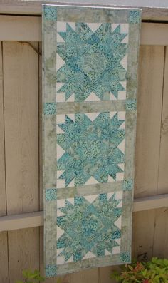 Beachy Batik Quilted Wall Hanging or Table Runner Turquoise Teal and Aqua. via Etsy.