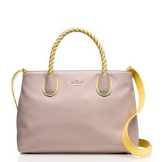 """Host PickKate Spade Woods Drive Bodie Woods Drive Bodie by Kate Spade in almondine/sunlight color. 8.9""""h x 13.6""""w x 6.4""""d. Drop length: 4.5"""" handheld. Soft pebbled cowhide with smooth leather trim. Quick & curious lining. Elbow bag with adjustable crossbody strap and ziptop closure. Interior zip and double slide pockets. Gold plated metal kate spade new york signature. Dust bag included. Imported. New with tags, unused. HOST PICK - 3/25/16. kate spade Bags"""