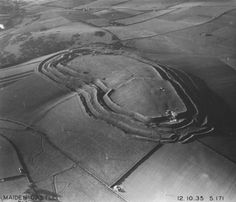 Iron age hill fort - aerial view of Maiden Castle, the largest hill fort in Europe, easily over run by the Romans in AD44