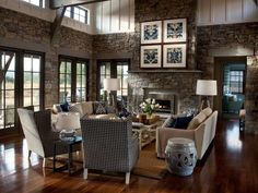 A sea of calming blue and serene cream in the home's great room complements interior stone cladding and connects the room to outdoor spaces.