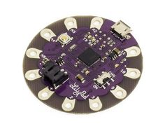 This sewable electronics microcontroller board can be programmed in the Arduino IDE. Designed to streamline your next sewable project and giving you more room to work while eliminating the need to sew a power supply. Microcontroller Board, Conductive Thread, E Textiles, Bar Graphs, Creative Design, Arduino Lilypad, Simple, Projects