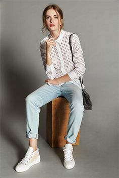 Styling Idea #3: White Shirt   A white shirt, sleek high-top sneakers, and graphic bag will quickly dress up this casual staple.
