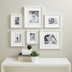 We have made a simple and easy solution to creating a stunning picture gallery wall. This set contains six white-painted wooden photo frames in varying sizes, which each have removable mounts to give your photographs a smart and modern look. Small Photo Frames, White Picture Frames, Photo Frame Ideas, White Frames, Photo Frames On Wall, Wall Of Frames, Photo Frame Layout, Family Photo Frames, Decoration Photo