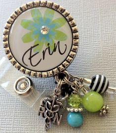 Personalized ID badge reel -RN, LPN Nurse Silver Pendant  - flower, medical symbol, medical office, nurse, nurse practitioner on Etsy, $19.00
