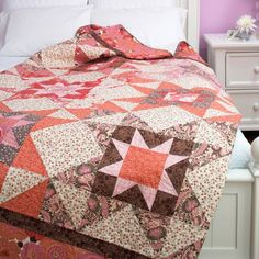 Pink can add a lot to a quilt--from sweet and feminine touches to modern pops of color! Free pattern to download.