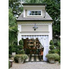 Imagine a live/work space like this garden shed. Live above, work below, short commute.    http://www.bhg.com/home-improvement/outdoor/shed-playhouse/a-gallery-of-garden-shed-ideas/#page=12