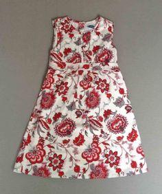 Patricia Mendiluce. Vestido estampado de flores en gris y rojo