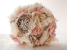 A feminine bouquet of fabric flowers made with vintage brooches found on Etsy or an inspiration to be realized at home. With a bouquet keepsake this beautiful, bridesmaids might become especially fearsome. Fabric Bouquet, Fabric Flowers, Diy Bouquet, Lace Bouquet, Blush Bouquet, Fabric Brooch, Cloth Flowers, Silk Flowers, Wedding Bouquets