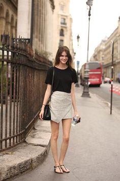 Spring fashion | Simple black t-shirt, stylish fold mini skirt, flats and a…