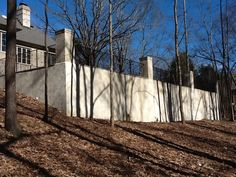 Large retaining wall built by Serenity Hardscapes