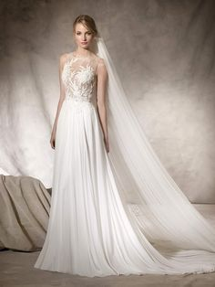 HAIKO is a flare wedding dress with intricate workings in gauze, Chantilly, lace, guipure and gemstones, with a bateau neckline and second skin effect