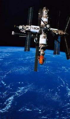 "n-a-s-a: ""Mir Spacecraft In Orbit Above Earth Print by Stockbyte on getty images """