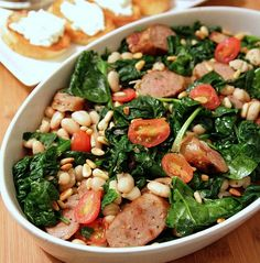 sausage, spinach, pine nuts & tomatoes