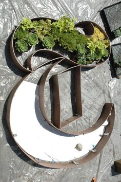 """""""Cutting the grass is about as far as my green fingers stretch, but I like this logo-growing project by Judy Kameon for the New York Times."""""""
