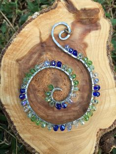 Artsy Swirl Pendant Wire wrapped with green and blue crystals by 3HippieChicks on Etsy