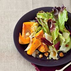 Roasted-Squash Salad With Maple Vinaigrette - Butternut squash, maple syrup, and hazelnuts give you incredible flavour for very few calories.