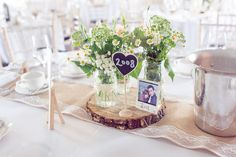 Wedding table decorations and flowers.  Natural Wedding photography at Sopley Mill, Sopley, Dorset created  by Lawes Photography  #sopleymillwedding #lawesphotography #weddingphotography #sopleymillweddingpictures #naturalweddingphotography #sopleymillnaturalweddingpictures