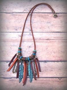 Bohemian Native American Leather Fringe Feather by Cheshujewelry