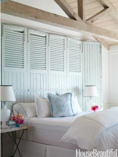 I like this idea for a headboard... we have smaller shudders in the garage that I have been making my husband save for a DIY project... maybe this is the one :)