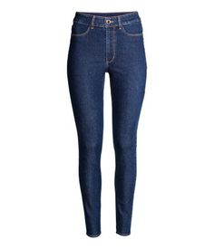 Dark denim blue. Trousers in washed superstretch twill with a high waist, slim…