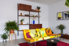 Joost and Martijn's living room showcases their signature style: bold colors and graphics playing nicely with sleek vintage pieces. The sofa is vintage IKEA, designed in 1984 by Danish designer Niels Gammelgaard. The upholstery fabric is a creation by Joost. What's extra special about it is that the individual pattern elements are so big there is no visible repetition.
