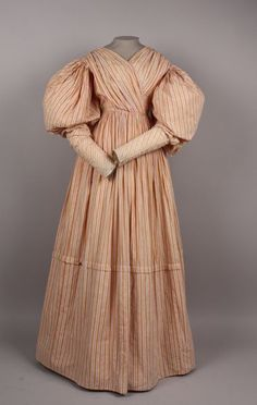 Date Made: 1825-35  Description:  Dress, cotton with woven stripes. Dress fitted but not boned, full length. Bodice opens center back from neckline to hip level; closes with 9 flat brass hooks and eyes.