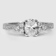 Two brilliant clusters conflict-free diamonds surround the center diamond in this unique setting.