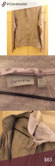 Athleta Strength Hoodie Only worn/washed twice. The strength hoodie is in excellent condition & perfect for the upcoming winter weather - it's very warm! It also has a pocket on the arm for iPod, keys, etc. Athleta Tops Sweatshirts & Hoodies
