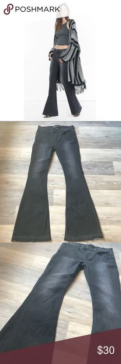"""Express Bell Flare Released Hem Jeans Express Bell Flare Released Hem Jeans Faded Black Wash Mid Rise Stretch  75% Cotton  24% Polyester  1% Spandex  NWOT Longer length   Size 8 Waist 15.5"""" Rise 10"""" Hips 18.5"""" Thigh 9.5"""" Inseam 34"""" Ankle/Flare 12"""" Express Jeans Flare & Wide Leg"""