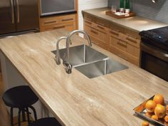 They may not be the real thing, but these inexpensive substitutes for pricey countertop materials might just be what you're looking for to perk up your kitchen without busting your budget.