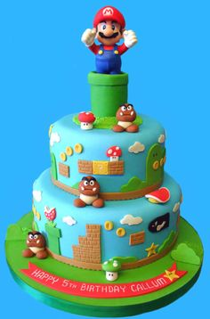 Beware of goombas, bullets and turtle shells! This cakebrings back the nostalgia of playing the original Super MarioBrothers. The topper for this cake is a 5 inch tall Mario figurewhich can be kept and played with long after this cake has beeneaten. Pastel Nintendo, Nintendo Cake, Nintendo Party, Bolo Do Mario, Bolo Super Mario, Luigi Cake, Mario Bros Cake, Mario Birthday Cake, Super Mario Birthday