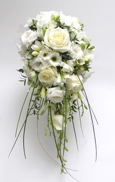 Shower bouquet of roses, lisianthus & freesia.