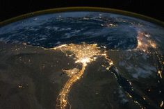 Nile River Delta at Night. One of the fascinating aspects of viewing Earth at night is how well the lights show the distribution of people. In this view of Egypt, we see a population almost completely concentrated along the Nile Valley, just a small percentage of the country's land area.