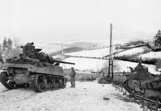 American tank destroyers wait on the snowy slopes of the Bastogne area picture show on Jan. 6,1945 in Bastogne,Belgium, ready to advance toward German lines as soon as the word is given. As they wait Gen. Patton's men slowly forge ahead into the German salient. (