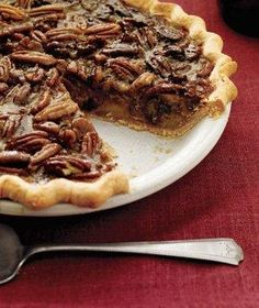 Bourbon and Orange Pecan Pie --  David Prince  -- Serves 8 -- Ingredients Basic Flaky Piecrust or 1 store-bought piecrust, fitted into a 9-inch pie plate 1 cup light corn syrup 3/4 cup light brown sugar 4 tablespoons unsalted butter (1/2 stick), melted 3 large eggs 2 tablespoons bourbon (or 1 teaspoon pure vanilla extract) 1/2 teaspoon grated orange zest 1/2 teaspoon kosher salt 2 cups pecan halves