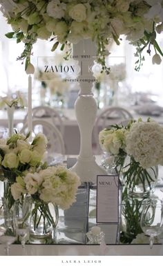 What a gorgeous wedding table, wit huge white floral mass arrangements, white flowers, mirror and white vases, orchids, roses, clear glass vases, royal wedding, best wedding day, best wedding ever