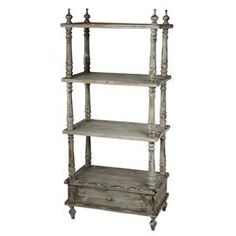 "Four-tier wood bookshelf with a distressed finish. Product: BookshelfConstruction Material: WoodColor: White washFeatures: Three tiersOne drawerDimensions: 56"" H x 26"" W x 16"" D"
