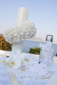Vintage wedding in Athens - White laces and fabrics, orchids Phalaenopsis,, tulips, calas, hydrangeas and anemones were decorating the reception venue and church. Apart from the wedding cake which was a real masterpiece decorated with handmade sculpted anemones from sugar - creation of Elite Events Athens , the wish table was so special & outstanding that the guests took didn't leave not even one koufeto or wedding buiscuits that were on the table! agios dionysios, island, ekklisia, varkiza
