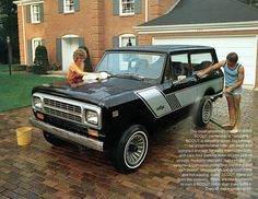 These people are washing a 1980 International Scout II Rallye 4x4 in cutoffs and a tank top...gotta love the early 80's.