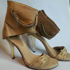 Leather above ankle sandal w/chains sexy shoe! New This is a sexy hot shoe.. well made.. All leather,  zipper in back.. your ankle doesn't shoe,  chains , and gold color heel.. perfect with a little dress! Size 6, new , never been worn,  bottom clean. . It has a cpl discoloration marks on the insole but that's just bc of the way I stored it.. doesn't really show when u wear it.. no trades Shoes Heels