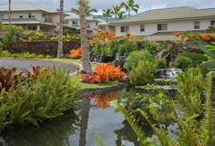 A colorful combination of tropical plants along with the water feature add to the beauty of this community gateway.  Kai Malu at Wailea, Maui