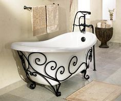 claw foot tub with wrought iron detail.